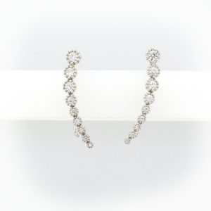 Graduated earrings with white stones decresing in size from the top in a curved arc line