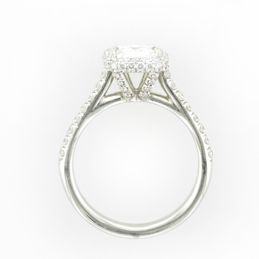 Side view of a white metal ring with a large stone on top