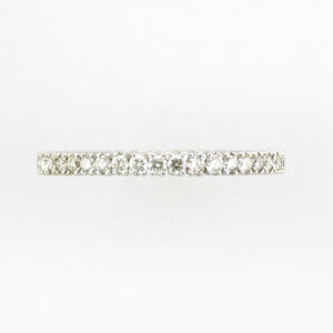 18 karat white gold ring is wrapped with prong set diamonds with a total weight of 0.70 carats with a rating of FG for color and VS for clarity.  ring is a size 6.5.