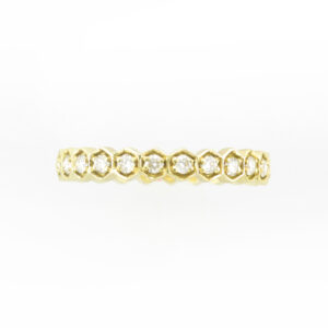 This 18 karat yellow gold ring has a hexagonal pattern holding stones with a total weight of 0.51 carats. This ring is size 6.