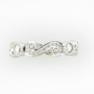 This 18 karat white gold ring has a scrolling pattern of diamonds that have a total weight of 0.64 karats.