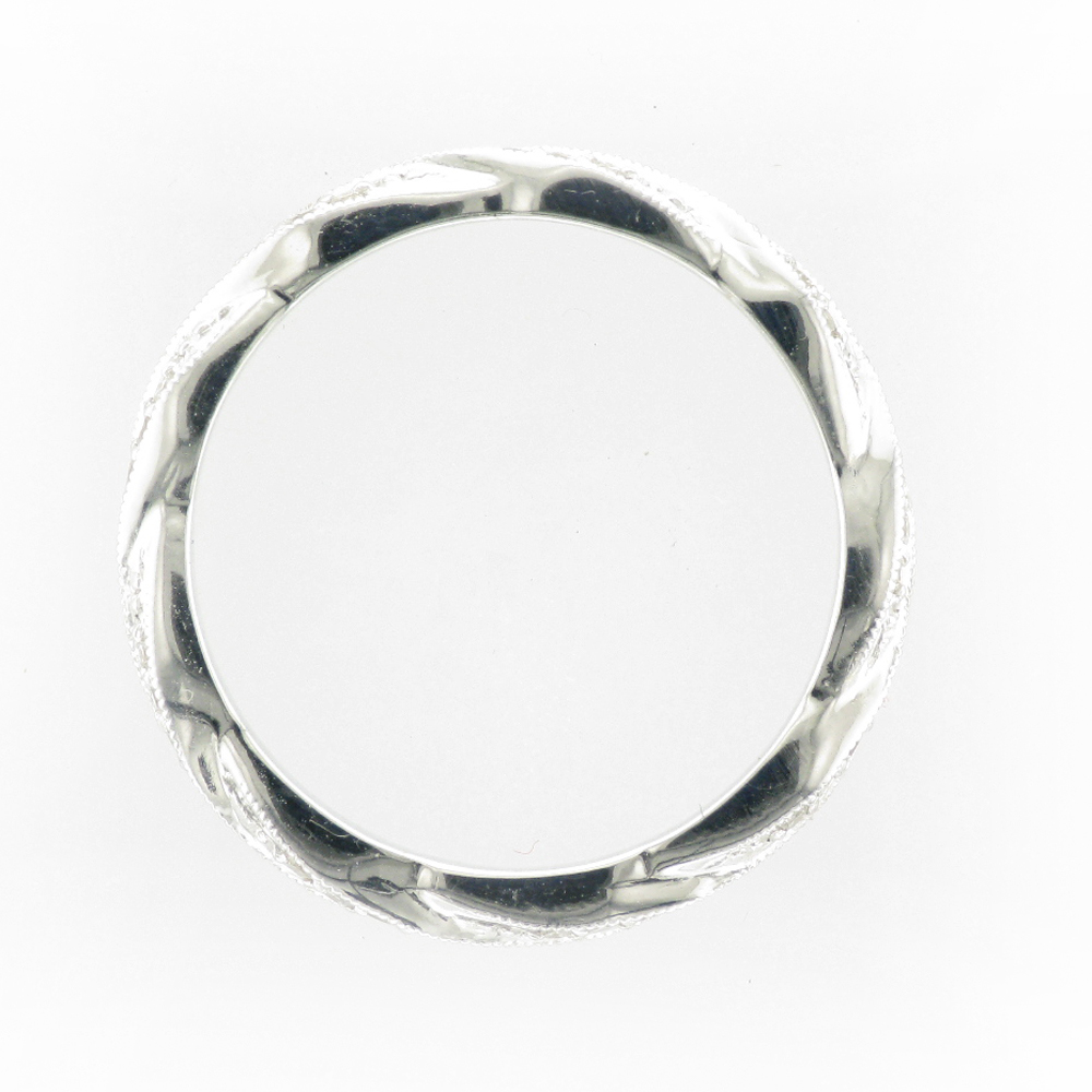 A white metal ring with a