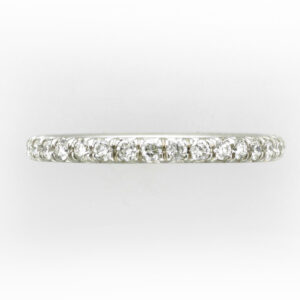 Platinum ring has a row of pave set diamonds around the band that have a total weight of 0.34 carats and a rating of F for color and VS for clarity.