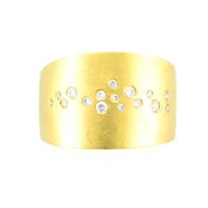 14 karat yellow gold ring has a scattered diamond pattern with a total weight of 0.17 carats.