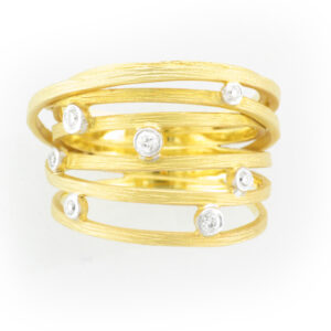 This criss cross open design ring is made from 14 karat yellow gold and has a total carat weight of .11.