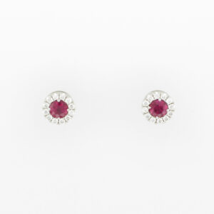 18 karat white gold earrings have fine rubies with a total weight of 0.40 carats and are surrounded by a total of 0.15 carats in stones.