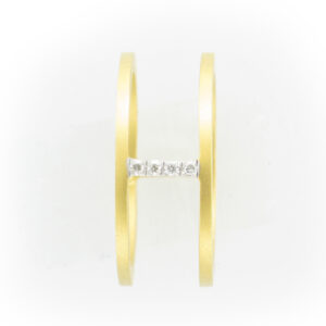 14 karat Yellow Gold is a open bar ring with Diamonds that have a total weight of .04 carats.