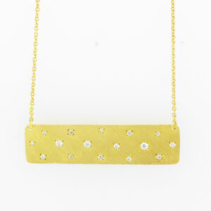 This necklace is made from a bar of 14 yellow gold karat that is dotted with a total weight of 0.16 carats in diamonds.