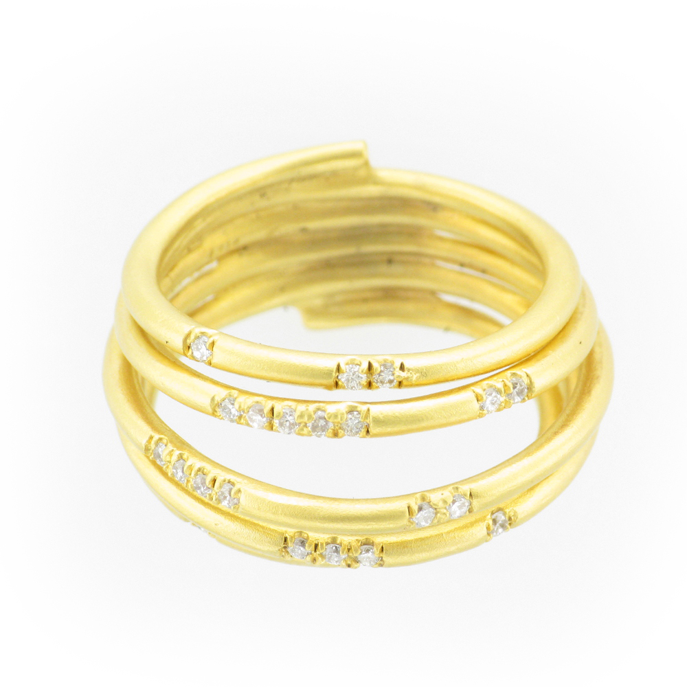 multi row ring is scattered with diamonds that have a total weight of 0.25 carats and is made from 14 karat yellow gold.