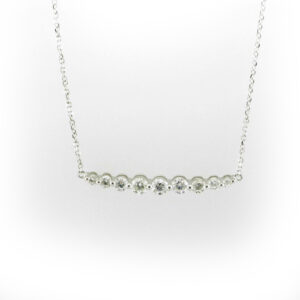 18 karat white gold necklace has a graduated row of stones with a total carat weight of 0.50 and a 17 inch chain.