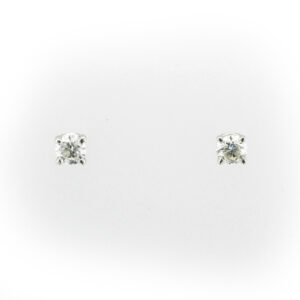 These 14 karat white gold earrings each have a diamond with a rating of G for color and SI2 for clarity, they are held by four prongs and have a total weight of 0.37 carats.