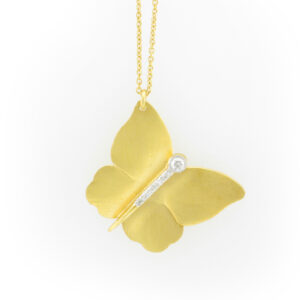 butterfly pendant is made from 14 karat yellow gold and has a total carat weight of 0.10.