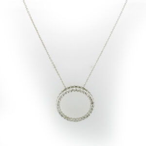 This 14 karat White Gold circle pendant has diamonds with a total carat weight of .45 and a 18 inch chain.