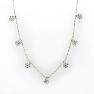 This 18 karat white gold necklace has floral drops that hold G/SI rated diamonds that have a total weight of 1.27 carats.
