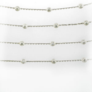 36 inch long chain has 31 bezel set diamonds with a total weight of 6 carats and a rating of G/SI1.
