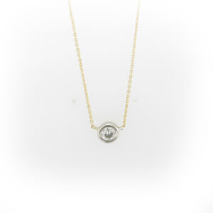 14 karat gold necklace has a 0.47 carat round diamond with a G/SI1 rating.