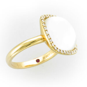 18 karat rose gold ring has Crystal, Mother of Pearl, and 0.24 carats of FG/VS diamonds.