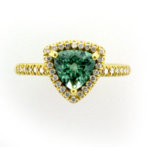 This 18 karat yellow gold ring holds a 1.33 carat trill fine green tourmaline with 0.31 carats of diamonds.