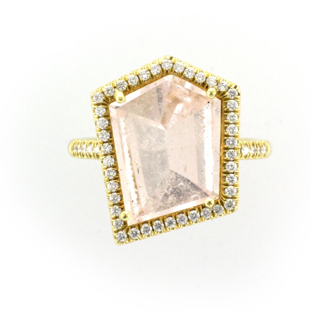 A yellow gold band with a clear pink stone