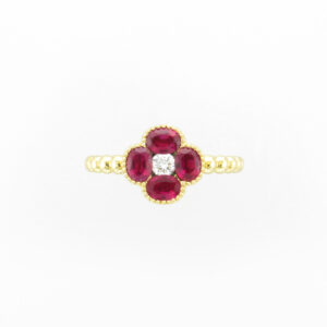 18 karat yellow gold ring has four fine rubies with a total weight of 1.40 carats and a total of 0.12 carats of diamonds.