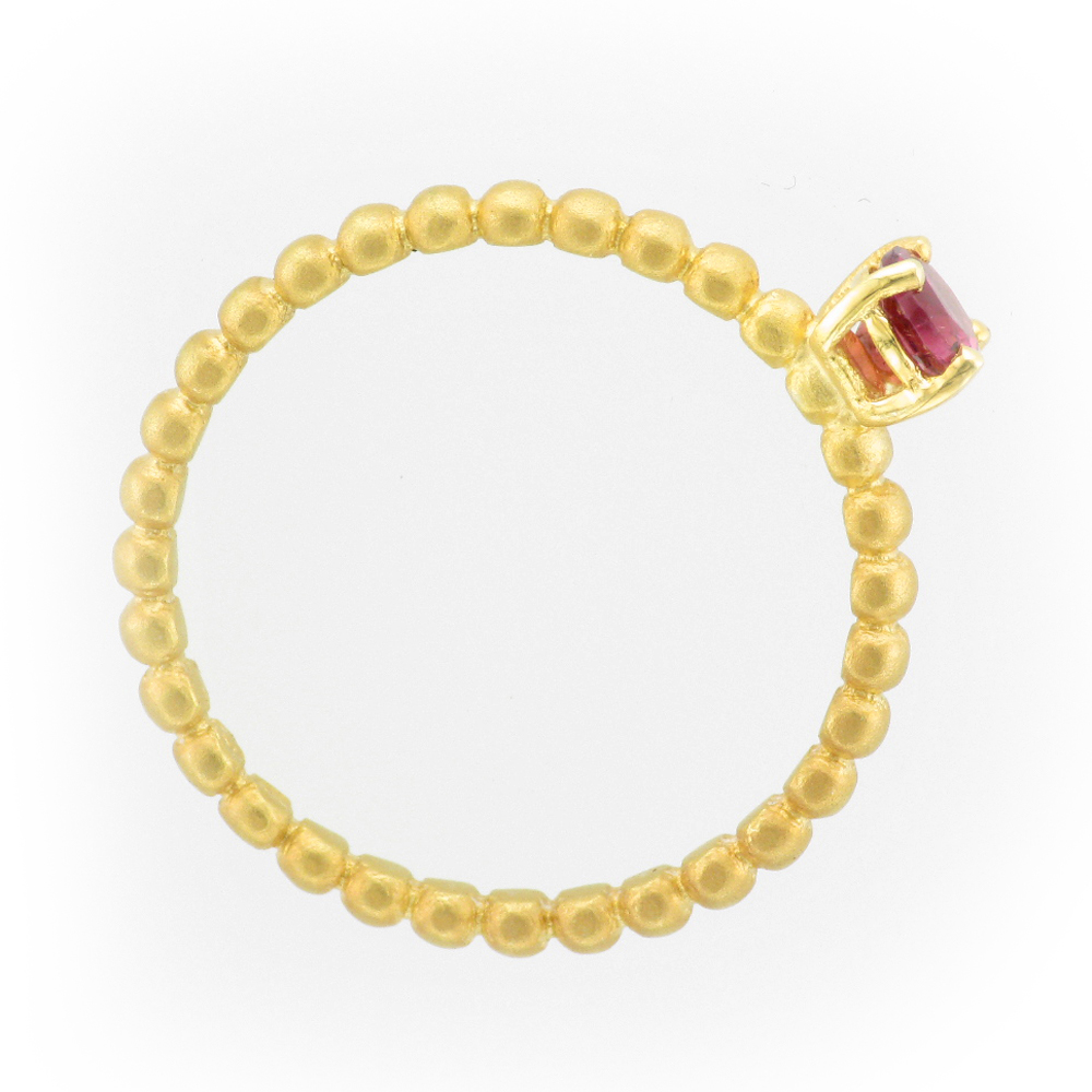 14 karat yellow gold stacking ring has a pink tourmaline.