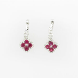 18 karat white gold drop earrings have 0.72 carats of rubies and .36 carats of FG/VS diamonds.