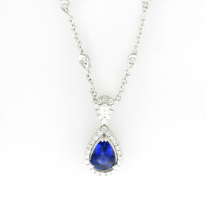 This 18 karat white gold necklace has a 1.59 carat blue sapphire and 0.53 carats in diamonds.