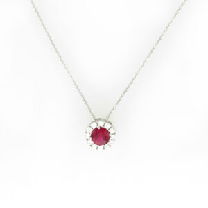 18 karat white gold necklace has a 0.30 carat ruby in the center and is surrounded by a total of 0.10 carats of diamonds.