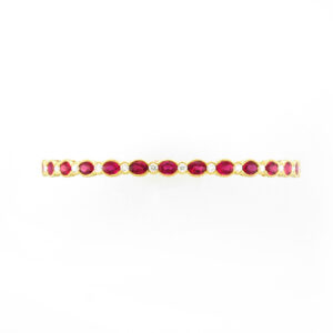 18 karat yellow gold bracelet has 14 fine rubies with a total weight of 3.22 carats and 13 diamonds.