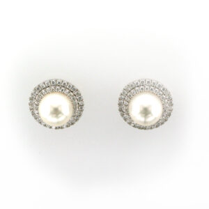 14 karat white gold earrings have 7.5 millimetre cultured pearl and a double halo of diamonds with a total weight of 0.45 carats.