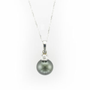 This 18 karat white gold pendant has a 9 to 10 millimetre Tahitian pearl, a 0.17 carat stone and is one a 16 inch chain.