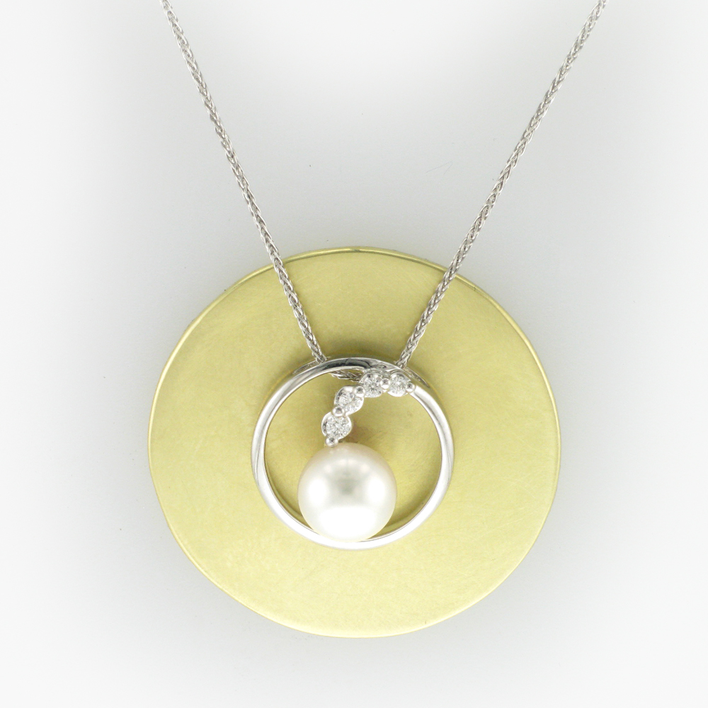 necklace has a 7.5 millimetre pearl and 0.08 carats of stones on a 16 inch baby wheat chain.