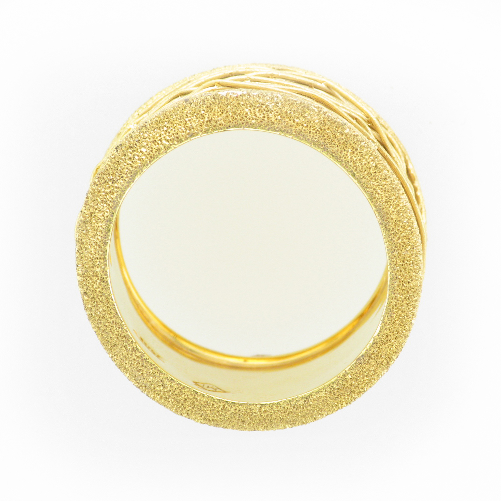 wide 14 karat yellow gold ring has a hand wrapped wire band with stone finished edges.