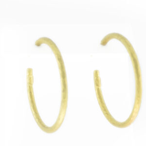 hoop earrings are made of 14 karat gold and have a matte finish.