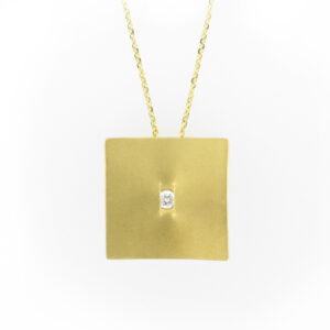 This 18 karat yellow gold sail pendant has a 0.12 carat F/VS diamond and a 14 karat yellow gold adjustable cable chain.
