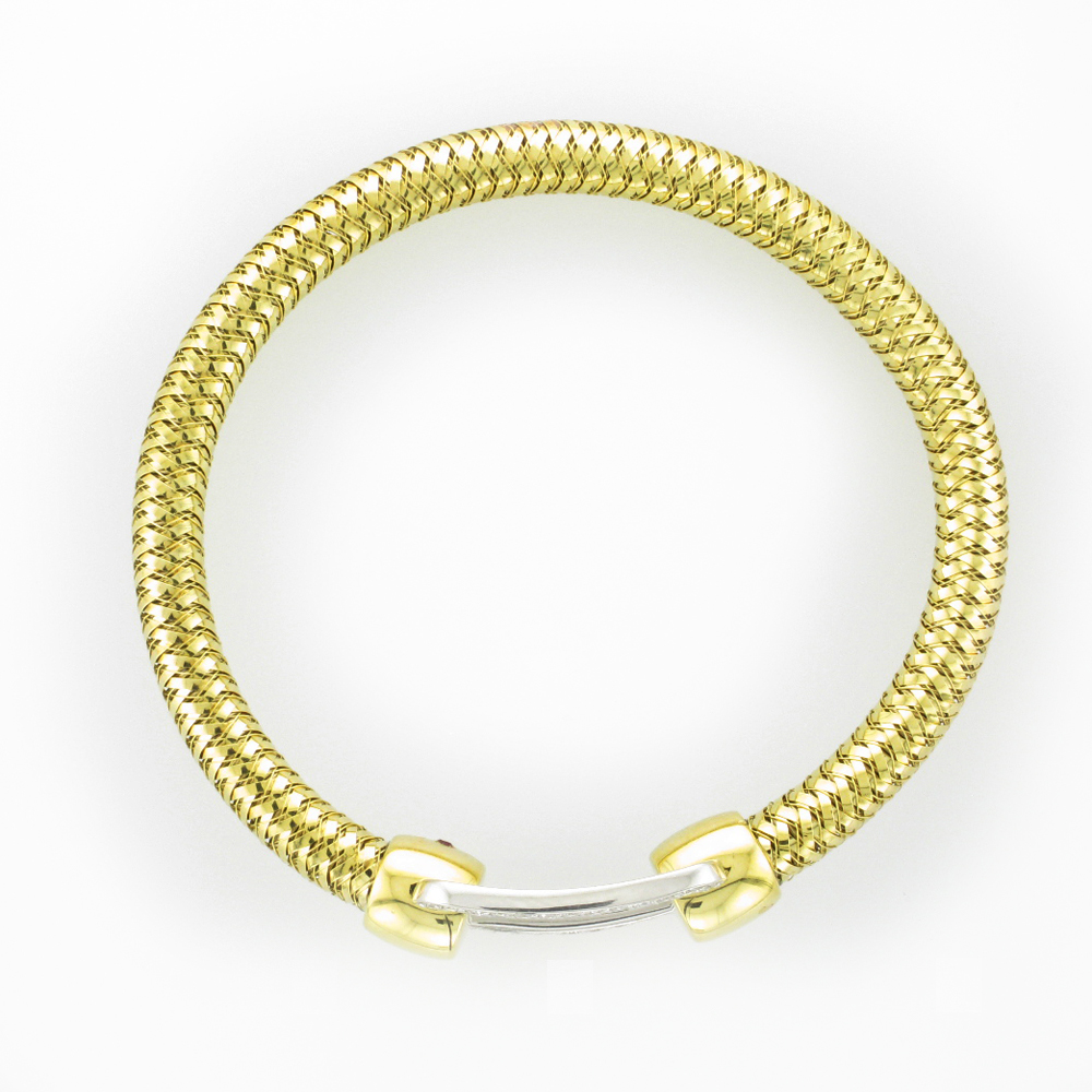 Top view of a woven gold bracelet with the ends connected by a white metal ring