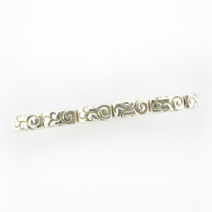 Bracelet is made out of sterling silver bars with swirl patterns.