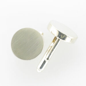 round cuff links are made of sterling silver.