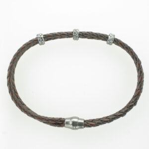 This bracelet has two brown braided strands and three black stations.
