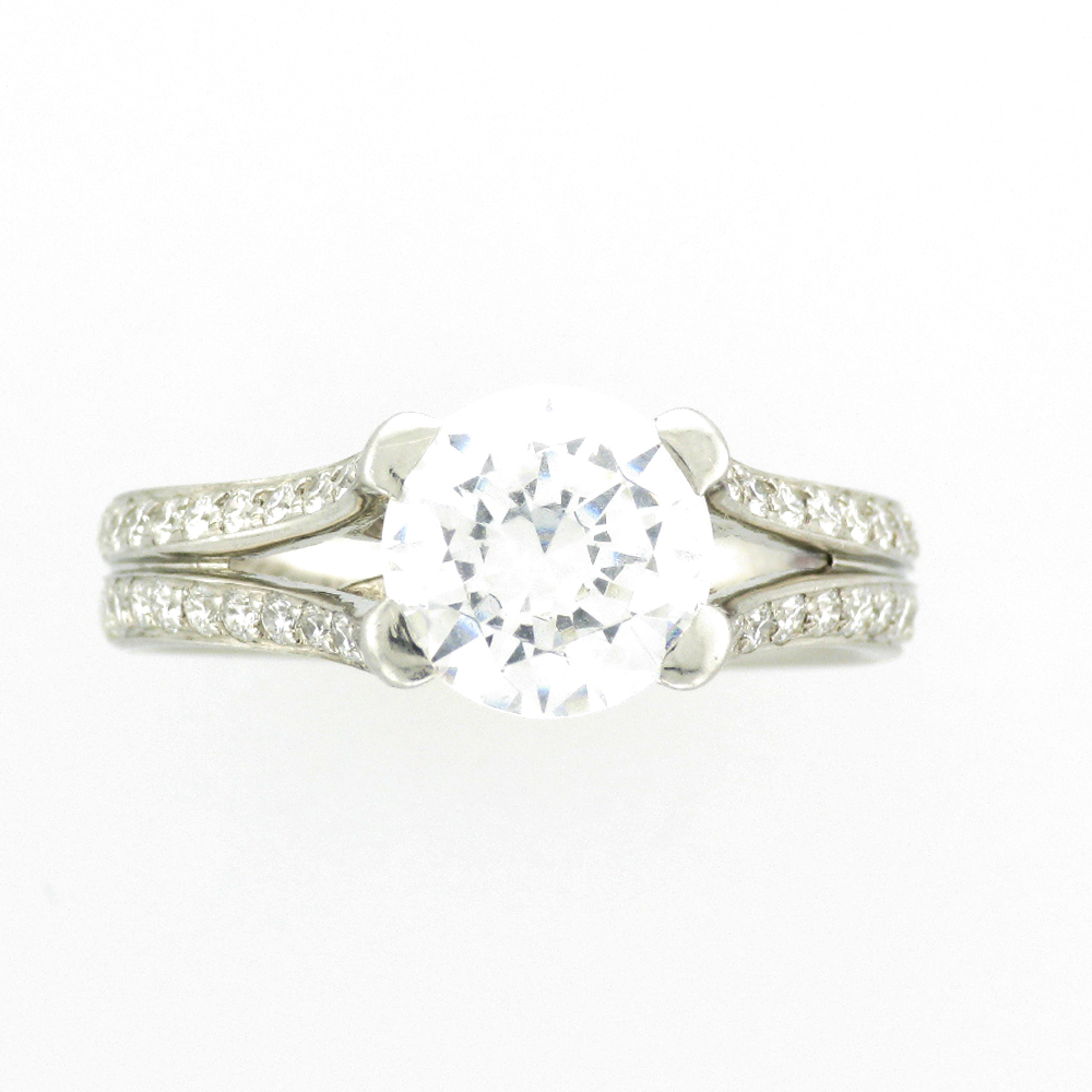 platinum and diamond ring has a mounting for a 2 carat round stone and pave settings with 0.45 carats in VS diamonds.
