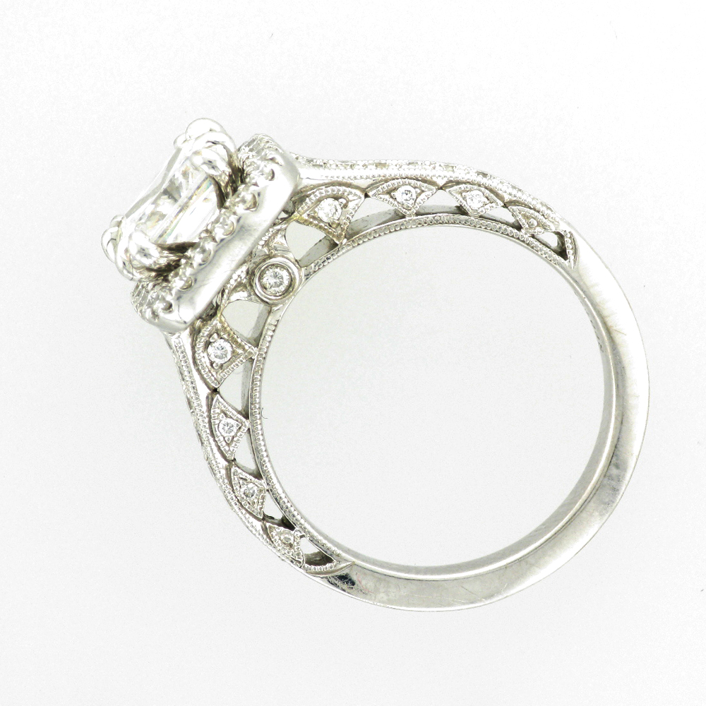 14 karat white gold ring has a stones with a total weight of 0.31 carats and has a double prong setting for a princess cut stone.
