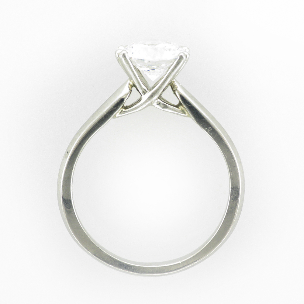 platinum ring has a knife edge criss cross eight prong setting.