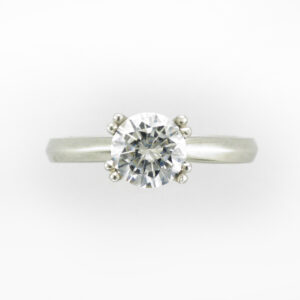 This platinum ring has a knife edge criss cross eight prong setting.