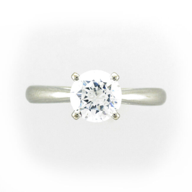 Solitaire Ring with Side Diamonds