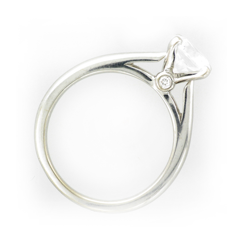 14 karat white gold solitaire ring has prongs for a 1.25 carat stone and has an additional 0.03 carats of stones.