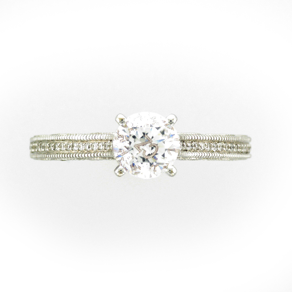 14 karat white gold ring has scalloped sides and a total weight of 0.29 carats FG/VS stones.