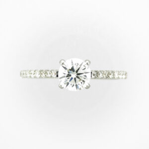 14 karat white gold has a 0.75 carat center diamond with a GIA rating of I/SI1 and 18 side stones with a total weight of 0.25 carats.