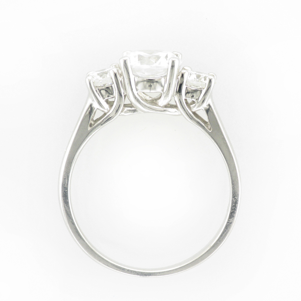 14 karat white gold ring has a trellis for the prongs and side diamonds with a total carat weight of 0.50 and are FG/VS.