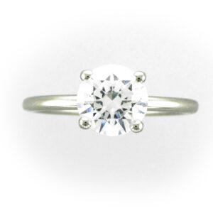 platinum ring as a 4 prong Solitaire setting.