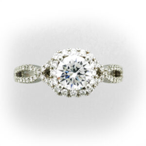 This ring has a criss cross band and settings for a 1 carat Center Stone.